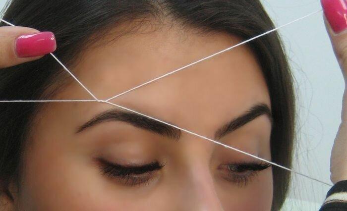 Коррекция бровей нитью, оформление